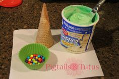 "Great idea to keep kids entertained. Waffle cones, icing/frosting tinted green and various candies for ""ornaments"" to include coconut, M&M's, sour straws...."