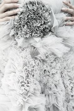 """Detail of a Giambattista Valli dress inspired by a chrysanthemum flower, featured in """"Giambattista Valli"""" published by Rizzoli."""