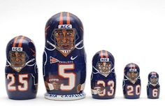 5 piece matryoshka doll set, featuring different famous Virginia Cavaliers football team players. This set is made by hand in Russia. It is made of linden wood and then painted by a professional matry