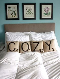 Scrabble Tile Pillows. Great idea for the sofa or bedroom and a great inexpensive way for me to add some new charm to my boring spots in the house.