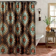 Bring a truly Southwest feeling to your bathroom's décor with the Suba shower curtain. It has a classic, yet modern Southwestern design reminiscent of Native American rugs in warm desert shades all printed on richly textured cotton fabric.