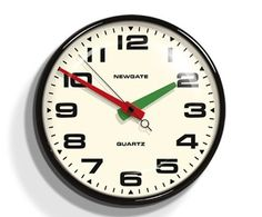 Brixton Wall Clock in Black design by Newgate Metal case clock, gloss black finish with convex glass lens and silent sweep motion second hand. Battery operated.