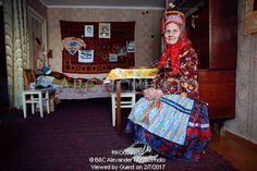 Image of maria zakharova, an 82 year old sami woman, in her apartment in lovozero. murmansk, kola peninsula, nw russia by ArcticPhoto