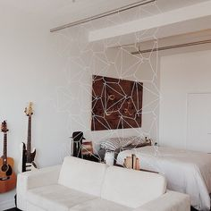 15 Space-Saving Ways to Style Your Bed in a Studio: If you've ever lived in a studio, you know exactly how tough it can be to figure out your furniture.