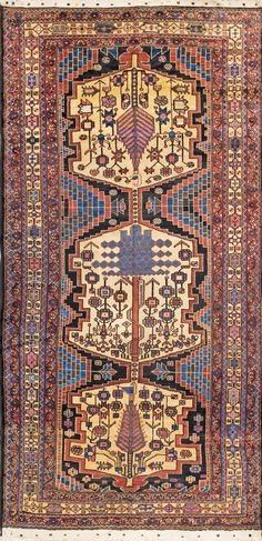 Persian rug, stylised trees (a blue cedar, and two cypress) and flowering plants medaillons.