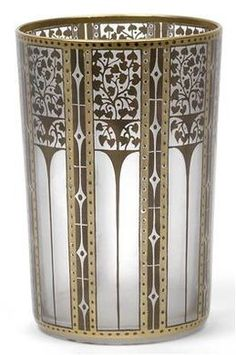 A beaker-shaped vase, designed by Josef Hoffmann, 1910/11, for J. & L. Lobmeyr, Vienna. Colorless glass decorated with gold-framed bronzite ornament against a matte ground.