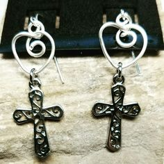 Silver wire wrapped heart earrings with Celtic crosses.