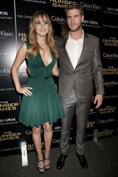 Jennifer Lawrence and Liam Hemsworth, both in Calvin Klein Collection at 'The Hunger Games' Premieres in New York Fabulous Dresses, Nice Dresses, Jennifer Laurence, Famous Stars, Liam Hemsworth, Calvin Klein Collection, Teen Choice Awards, Girl Quotes, Hunger Games