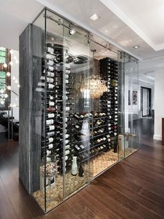 Modern wine display cabinet with glass doors and tons of corks. Such a great design