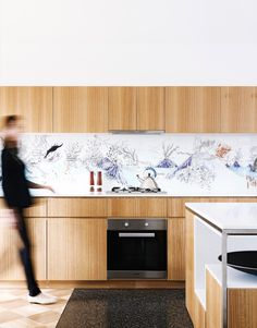 Splashback illustration by Alex Hotchin in Melbourne house by Steffen Welsch Architects. Styling: Heather Nette King | Photography: Eve Wilson