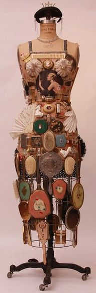 Vintage mirror collection displayed on an antique dress form.