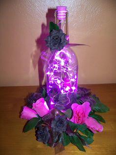 Centerpiece lighted wine bottle with silk flowers
