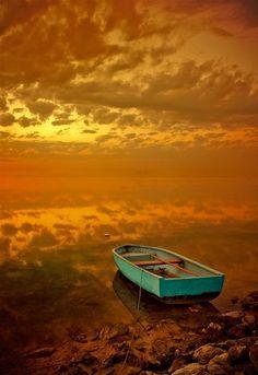 aqua boat yellow sky