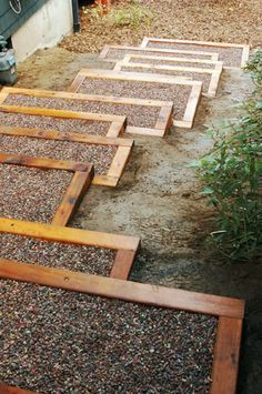 Garden stairs made from stained wood frames, filled with gravel (or maybe slate chips)