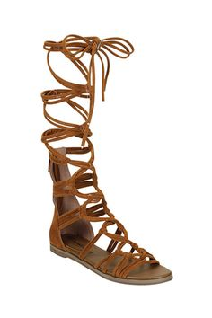 The world is yours to rule in these beauties! Channel your inner goddess and snag these gladiator sandals of epic proportion. Get the sandal that not only makes a statement,but commands it!