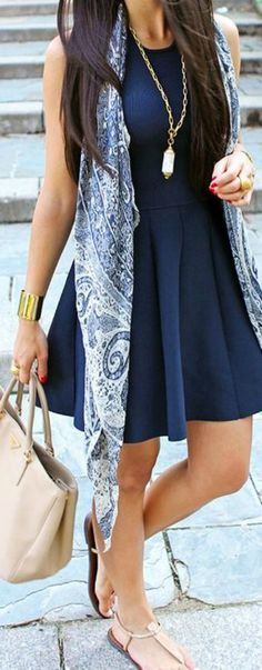 I am falling in love with navy these days; it's not as harsh as black. How cute is that scarf draping the whole outfit?