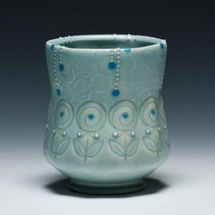 An Exhibition on Water and the Ceramic Cup. - 68 artists near 350 cups    Kristen Kieffer (Rain Flora)