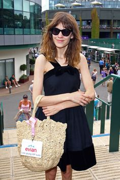 alexastyle:    Alexa Chung poses for photos outside the Evian Suite at Wimbledon on June 28, 2012 in London, England.