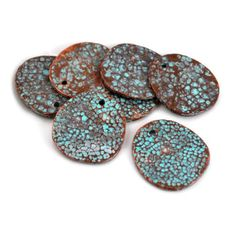 Mykonos Moonscape Disk- 29mm high- these discs are made of lead-free base metal, then dipped in copper and finished with a green patina. Each irregular disc makes these rustic and beautiful!   [2-$6.00]