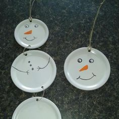 canning lid snowmen. Could also use white paper plates for kids craft!!