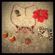 Fantasia Set All items are part of this listing. Hamburger ring is adjustable. French fries and real blown glass cherry earrings are both for pierced ears. (Button is to keep cherry earrings together). Pink flower is a hairclip. Necklace (choker) is 2 pink ol' school Americana tattoo style Swallows w/ a day of the dead skull on end. Leopard bow is a hairclip & features an Americana tattoo style 1920's day of the dead girl w/ a broken heart tattooed on her shoulder. If you have any Q's, I'm…