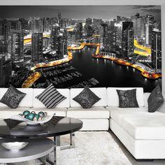 Foto-tapeta z atrakcyjnym widokiem na oświetlony Dubaj upiększy każdy salon.