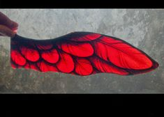 An exquisite English architectural antique. This is a fine, large scale, stained glass fragment of an angel wing in ruby red. It once formed part of an 1800s leaded, gothic revival, stained-glass church window. The wing is skilfully crafted by a skilled Victorian stained glass artisan.