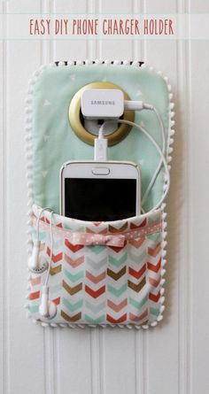 This DIY Phone Charger is so easy to sew up and makes such a cute holder for your phone while it's charging!   Find fun fabrics for your next project www.myfabricdesigns.com