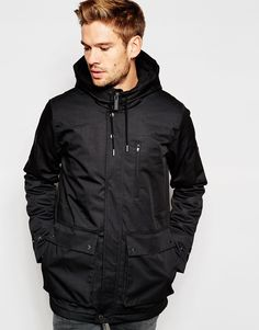 """Parka by Native Youth Smooth, woven outer Fleece lining Hood with drawstring Concealed zip and press stud placket Drawstring waist Functional pockets Fishtail hem Regular fit - true to size Dry clean 64% Polyester, 36% Cotton Our model wears a size Medium and is 183cm/6'0"""" tall"""