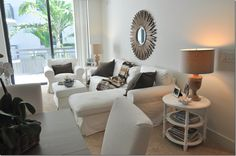 The side tables and mirror are from Wisteria and the lamps are from Ballard Designs. Furniture Ikea.
