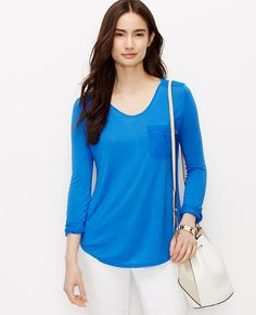 Flaunting a mix of woven sportswear details, this versatile jersey style is one of summer's wardrobe anchors. Scoop neck. 3/4 sleeves with button tabs. Front patch pocket. Back yoke with button tab. Shirttail hem. Woven neckband, pocket, yoke and sleeve tabs.