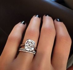 This is a beautiful setting. The diamond, the band - perfect! Do not like the smaller pair of diamond bands below the rock.