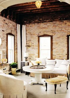 bright with lots of texture, brick, wood, soft sofa, this is a beautiful room | greige: interior design ideas and inspiration for the transitional home : Texture and Lignt..
