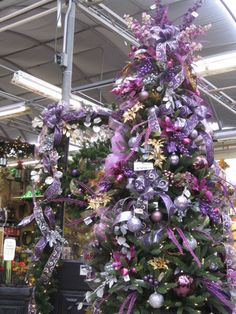 Christmas Tree & Garland From the Purple, Purple, Purple Theme at Your Christmas Shop at Stauffers of Kissel Hill Garden Centers. (http://www.skh.com/home-garden/departments-2/the-christmas-shop/)