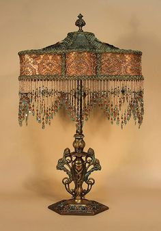 Ornate, painted metal table lamp holds a 'KATIE' shaped shade. Ombre dyed from teal blue into terra cotta. Old Lamps, Antique Lamps, Antique Lighting, Vintage Lamps, Antique Metal, Victorian Table Lamps, Victorian Furniture, Victorian Decor, Antique Furniture