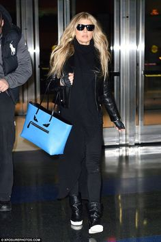 High fashion! Fergie hit another fashion high note in her leather jacket when she arrived to JFK Airport on Friday