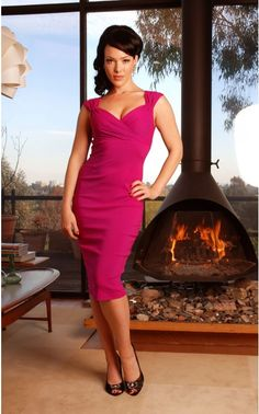 One of our best-selling, super sexy bengaline wiggle dresses, the Erin Dress is berry-pretty in this vibrant shade of fuchsia! Inspired by screen icons of the 1950s but made for the modern lady, this dress has a gathered neckline, cross-over style bust, gathers at the shoulder, a back zip and walking slit, and flatters women of all sizes! - See more at: http://www.pinupgirlclothing.com/erin-dress-berry.html#sthash.05qHAghV.dpuf