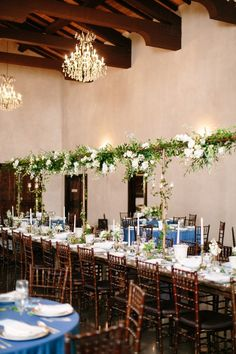 Greenery wedding reception decor - long tables with hanging greenery and white flowers {Ma Maison}