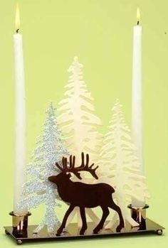 """10"""" Home for the Holidays Deer with Winter Scene Christmas Candle Holder by Roman. $24.99. From the Home for the Holidays CollectionItem #36163Features a silhouette of a deer standing in front of whimsical winter trees.Silver tree is accented with glitterHolds (2) taper candles (not included)Dimensions: 10""""H x 3""""W x 9""""DMaterial(s): metal/man-made materials"""