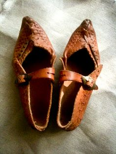 "A pair of traditional Polish folk costume shoes called ""Kierpce"""