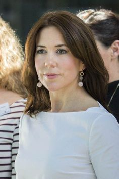 Crown Princess Mary accesorised with a pretty set of earrings that went well with her white top.