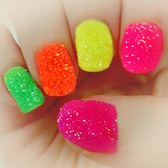 12 Wild Ways to Rock Neon Nails This Summer | Family Style  just paint your nails a neon color and sprinkle neon glitter!