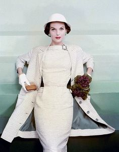 Anne St. Marie wearing blue on white striped linen dress with matching coat and round white linen hat, Jan.1955, photo was used for the cover of Vogue.