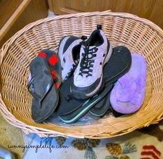 Camping shoe basket, keep shoes organized and dirt out of the tent or rv - Must Do Camping Hacks @ sunnysimplelife.com #camping #rv #organized