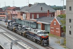Here's a shot from yesterday of the Central of Georgia heritage unit as it makes its debut on her home rails, former Central of Georgia territory between Macon, Columbus, and Birmingham. In this shot the the heritage unit passes by the old Central of Georgia passenger station in Columbus, Ga.