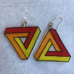Shrinky DInk Triangle Earrings suspended from silver sterling earring hooks