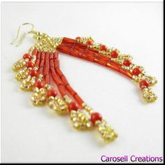 Beaded chandelier dangle red and gold earrings. These are made by weaving seed, bugle and 4mm party beads together in this colorful design. The party beads are a swirl of red and gold colors mixed together that really add to making this piece shine. These are light weight for comfortable