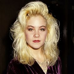 80s Christina Applegate. I must have gone through a zillion cans of Aqua Net trying to get those bangs!...YUP!! Me too!!!