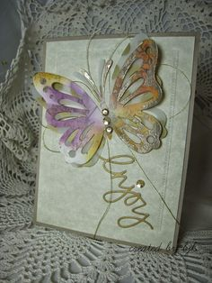 created by bjk - Die cut first butterfly from watercolored paper & another butterfly from some gold polka dot vellum and a sentiment from gold card.  The background was dry embossed with another die.  Added some gold thread behind the butterfly and a few sequins