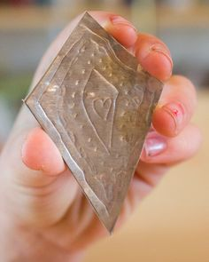 If you've got kids (or a Scout troop, or a day camp...) who love making jewelry, then they'll love making these embossed aluminum pendants.